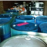 Photo of hazardous waste containers in a trailer