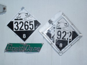 hazard class 8 corrosive placards UN3265 and UN2922