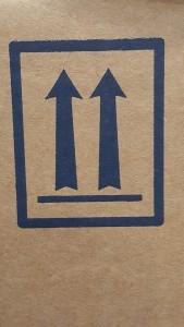 Package orientation arrow on HazMat Packaging