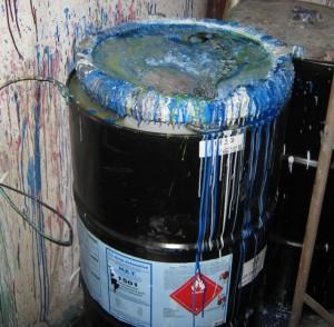 Hazardous waste container in poor condition