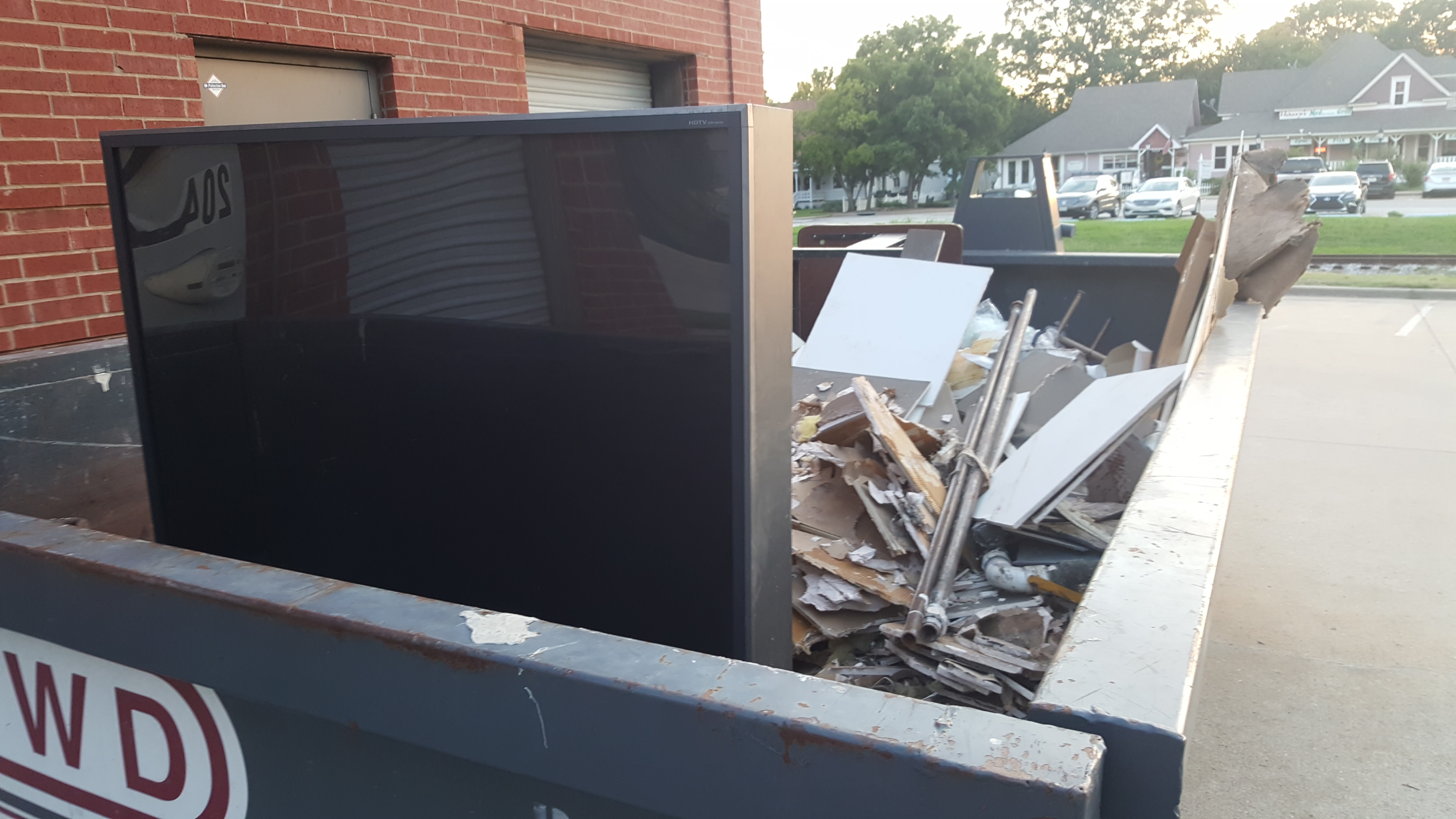 Large Flat Screen Tv In Trash Dumpster